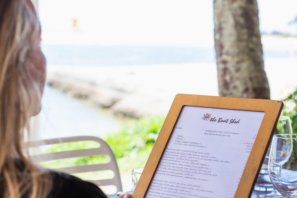 The Boat Shed Restaurant Woman Viewing Menu